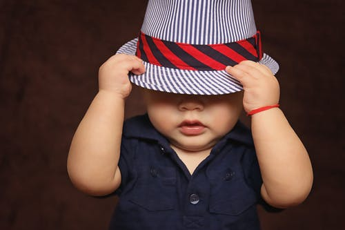 baby boy hat covered photo